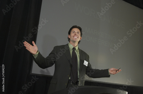 Mid adult man during presentation at conference