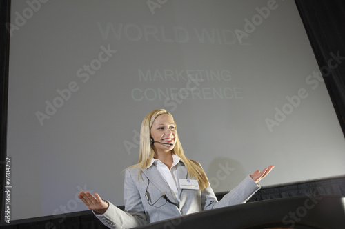 Young woman during presentation at conference