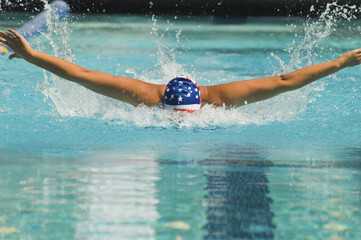 Woman swimming butterfly stroke