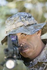 Soldier using rifle, outdoors, close-up