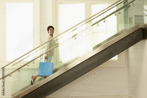 Woman Walking up Stairway