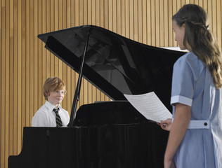 Two students performing in music class