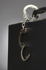 Handcuffs attached to briefcase in studio