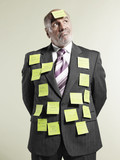 Businessman wearing sticky notes
