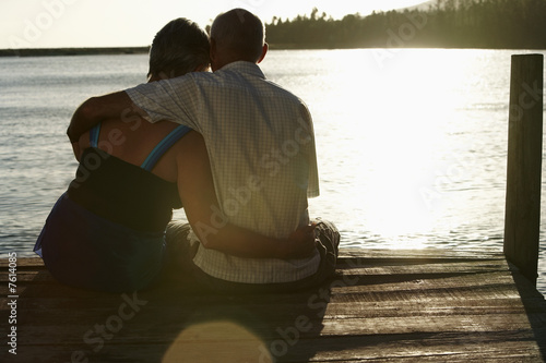 Couple Watching Sunset over Lake