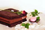 braune Handtücher mit Seife poster