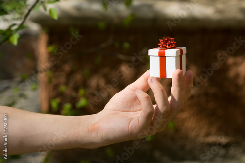 Young man with gift box