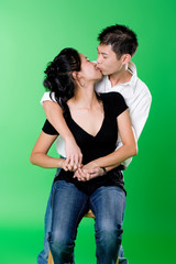loving young asian couple kissing each other