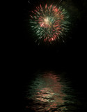 Fireworks with reflexes on water poster