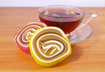 Colorful fruit candy and tea