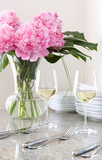 cutlery, wine, plates & flowers