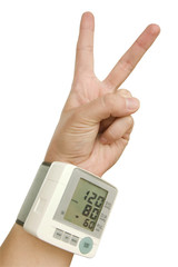 Hand of healthy person with tonometer in victory sign