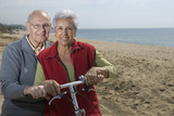 Active senior couple biking poster
