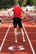 An older man preparing to run a race