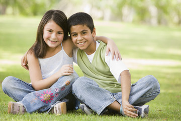 Two children sitting in park