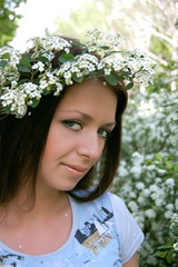 Beautiful girl with white flower diadem