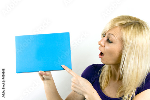 Woman holding a blank notecard