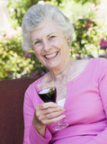 Senior woman enjoying glass of wine
