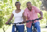 Senior couple on cycle ride poster