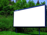 Blank advertising billbord on the street with trees poster