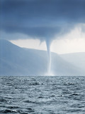 Tornado forming over sea - 7665802