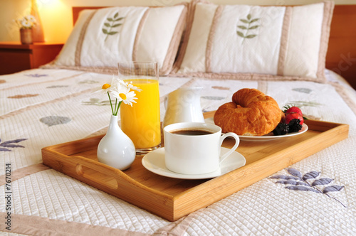 Staande foto Assortiment Breakfast on a bed in a hotel room