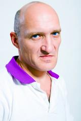 Portrait of the man indignation. Blue eyes. Bald