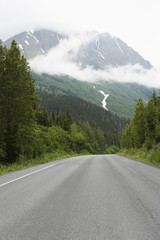 USA, Alaska, empty road in mountains