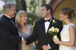 Bride, groom and parents exchanging wishes