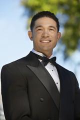 Portrait of boy 13-15 in tuxedo at Quinceanera