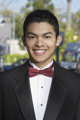 Portrait of boy 13-15 in tuxedo at Quinceanera