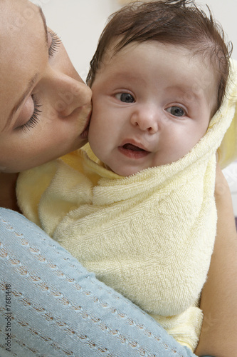 Woman kissing baby 1-6 months, close-up