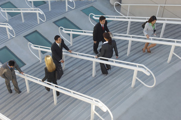 Business people moving up and down stairs, elevated view