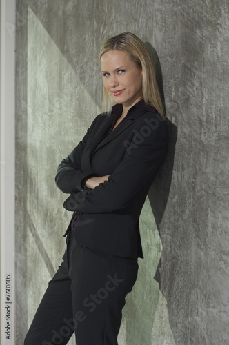 Portrait of businesswoman leaning on wall