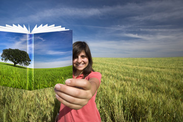 young woman smiling holding book with colorful cover