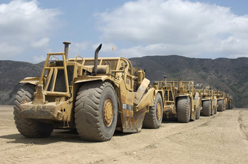 Row of trucks at landfill site