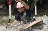 Young woman whitewater kayaking