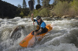 Man kayaking on mountain river