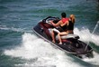 Young Couple on a Black Jetski
