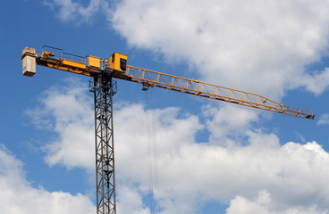 lifting crane uder blue sky