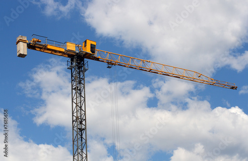 lifting crane uder blue sky