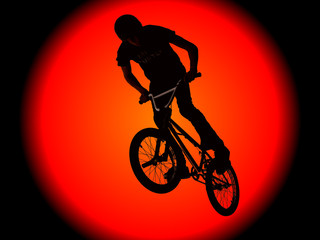 Biker boys silhouetted against a huge sun