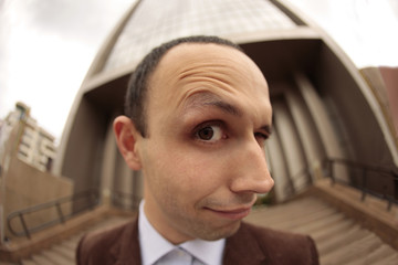 close up with a fish eye of a man face with the eyebrow raised