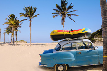 oldtimer parked on the sands of tropical beach