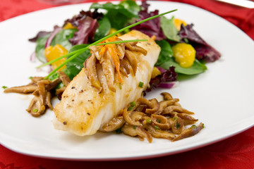 Sea bass with shiitake mushrooms and salad