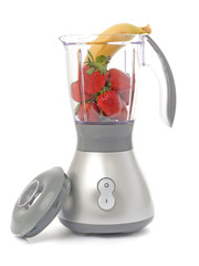 Blender with strawberries and one banana