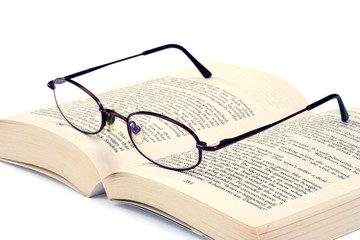 Book and an eyeglasses