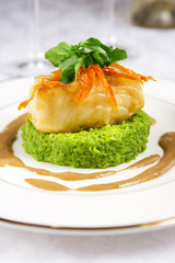 Sea bass served with pea mash and mushroom sauce