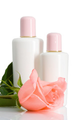 two cosmetic bottles with rose