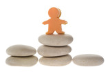 Figurine on stacks of pebbles representing an awards podium poster